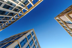 Looking up at three business buildings Stock Photography