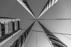 Free Looking Up Through The Support Cables At Golden Gate Bridge Support Tower In Black And White Stock Photography - 132341842