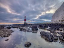 Looking up to Beachy Head light and cliff - a stitched panorama processed with HDR technology - taken from below the light house stock photography