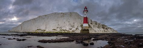 Looking up to Beachy Head light and cliff - a stitched panorama taken from below the light house at Beachy Head, East Sussex, UK royalty free stock photos