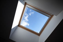 Looking up to the blue cloudy sky. Through modern square ceiling window Stock Images