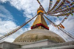 Looking up to Boudha Stupa and prayer flags, Kathmandu, Nepal Stock Photos