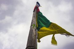 Looking up to buddhist prayer flag stock photo