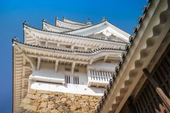 Looking up to the elegant architecture of Himeji Castle in Japan. Looking up to the elegant architecture of the main tower of Himeji Castle with its white eaves royalty free stock photography