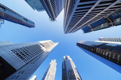 Free Looking Up To High-rise Buildings, Skyscrapers, Architectures In Smart City For Technology Background In Singapore City With Blue Stock Photos - 136055223