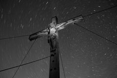 Looking up to Jesus and a million star trails. Royalty Free Stock Photo