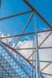 Looking up at the top architectural structure of an interstate bridge with blue skies and puffy white cloud in the background - di royalty free stock photos