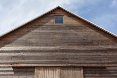 Looking up at the top of a gabled roof on a wooden barn. In farmland Royalty Free Stock Image