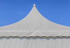 Looking up at the top of white tent with blue sky background Stock Photos