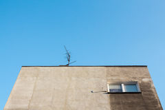 Looking up towards the grey facade of socialist housing in easte royalty free stock image