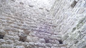 Looking up in the tower of a castle ruin stock footage