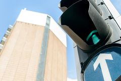 Looking up at a Traffic Light with a High Rise Building in the b. Ackground, shallow depth of field Royalty Free Stock Image