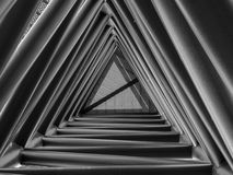 Looking up through triangle structure. Inside stairway Stock Photography