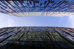 Looking up between two modern business skyscrapers, high-rise bu royalty free stock photos