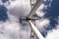 Looking up under a giant ferris wheel royalty free stock photo