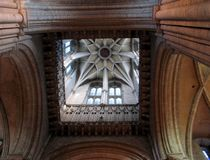 Looking Up. Wards at the huge arches and up into the bell tower inside Durham Cathedral royalty free stock photos