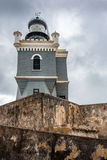 Looking up view of the lighthouse in Castillo San Felipe del Mor. Ro with stormy sky and anient stone walls Stock Photos