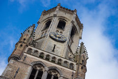 Looking Up View Of The Medieval Bell Tower  Belfort Belfry  With Tower Clock And Cloudy Sky. Medieval Famous Landmark Tower Bel Royalty Free Stock Image