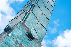 Looking up view of Taipei 101, the landmark of Taiwan, reflect blue sky and sun lights Royalty Free Stock Photography