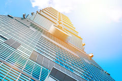 Looking up view of Taipei 101, the landmark of Taiwan, reflect blue sky and sun lights Stock Images