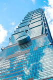 Looking up view of Taipei 101, the landmark of Taiwan, reflect blue sky and sun lights Stock Photography