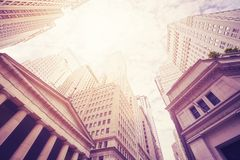 Looking up at the Wall Street buildings, NYC. Royalty Free Stock Photo