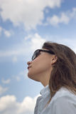 Looking up at woman looking up to sky Stock Images