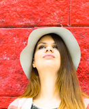 Looking up. A Woman is Smiling while looking up , Beautiful Face and hair Royalty Free Stock Image