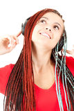 Looking up young girl with headphones Stock Photography