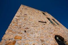Looking upward at a brick or rock walled building Royalty Free Stock Photos