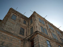 Looking upward at old Prison building. On Alcatraz Island, California stock photography
