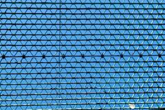 Looking upward at the sky, through a metal grid stock photography