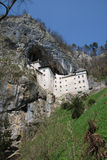 Looking Upwards to Predjama Grad, Slovenia Royalty Free Stock Images
