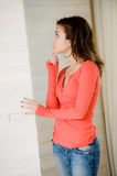 Looking In Wardrobe. A young woman looking in her wardrobe trying to decide what to wear Royalty Free Stock Image