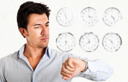 Looking at the watch Stock Photo
