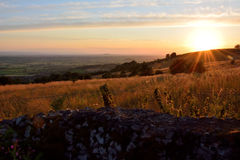 Looking west from the Mendip Hills as the sun sets. A view over Somerset and the Somerset Levels from an Area of Outstanding Natural Beauty Stock Photos
