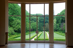 Looking Through Window. A view of the garden from the interior of a luxury house Royalty Free Stock Image