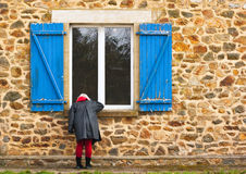 Looking through window. Woman looking through a large window Royalty Free Stock Photography