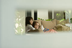 Looking through a window. At two girls talking to each other Royalty Free Stock Image