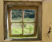 Looking through the window. Of an abandoned building Stock Photo