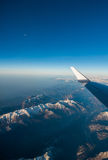 Looking through the window aircraft during flight a snow covered Italian and Osterreich Stock Photos