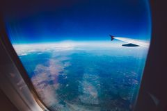 Looking through window aircraft during flight in wing blue sky Stock Images