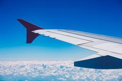Looking through window aircraft during flight in wing blue sky Stock Photo