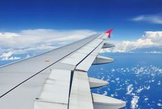 Looking through window aircraft during flight Royalty Free Stock Images