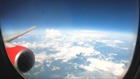 Looking through window aircraft during flight in wing with a nice blue sky. Looking through window aircraft during flight in wing with a nice blue sky stock video footage