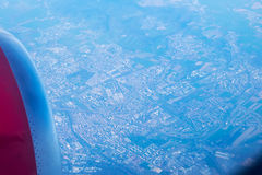 Looking through window aircraft. High-angle view from airplane. Stock Images