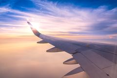 Looking through window aircraft wing. During flight and look cloud in beautiful Stock Photography