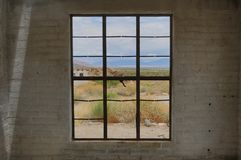 Looking through a Window at the Coachella Valley. Looking through the window of an abandaoned bulding at Indian Canyons, with a view of the Coachella Valley in stock photos