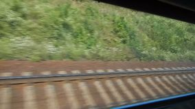 Looking through the window of fast-moving train, railway road. Stock footage stock video footage