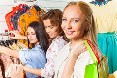 Looking woman and her friends in shop Stock Image